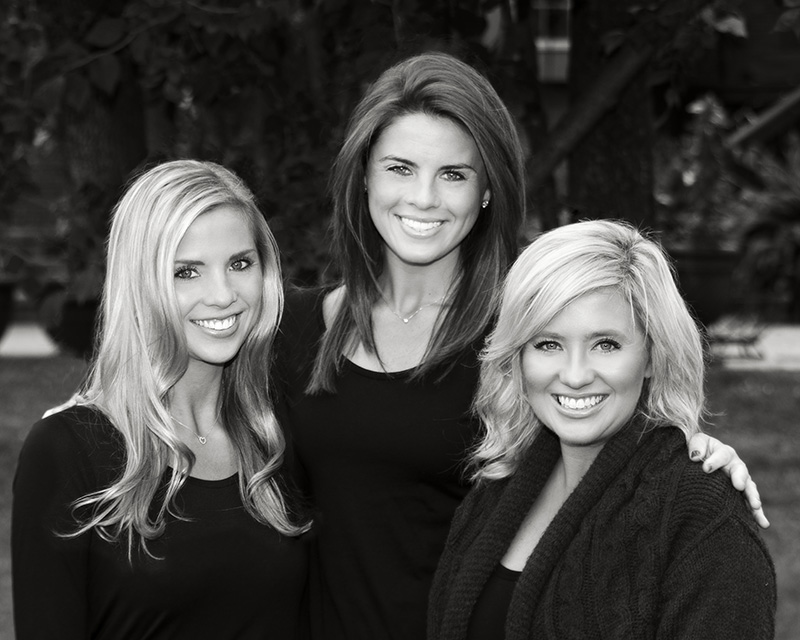 outdoor portrait of three sisters in black shirts by Dan Cleary of Cleary Creative Photography Dayton Ohio