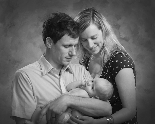Black & White portrait of parents holding their new baby boy
