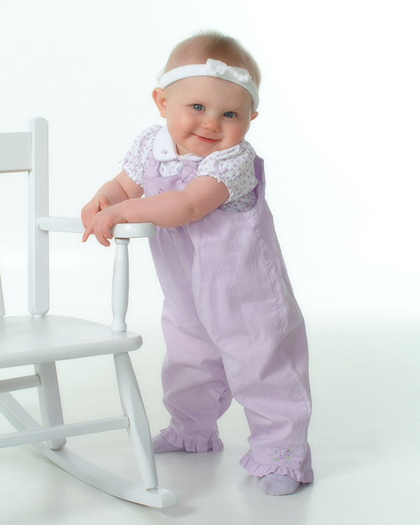 studio portrait of 9 month baby girl in purple outfit by Dan Cleary of Cleary Creative Photography in Dayton Ohio