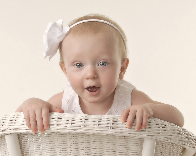 one year old baby girl sitting backwards on a chair by Dan Cleary of Cleary Cretive Photography of Dayton Ohio