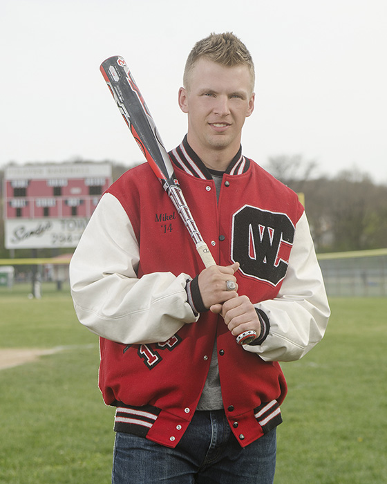 portrait of  High School senior boy with baseball bat
