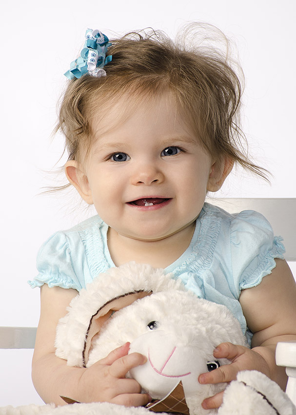 Nine Month Baby portrait holding stuffed animal by Dan Cleary of Cleary Creative Photography in Dayton Ohio