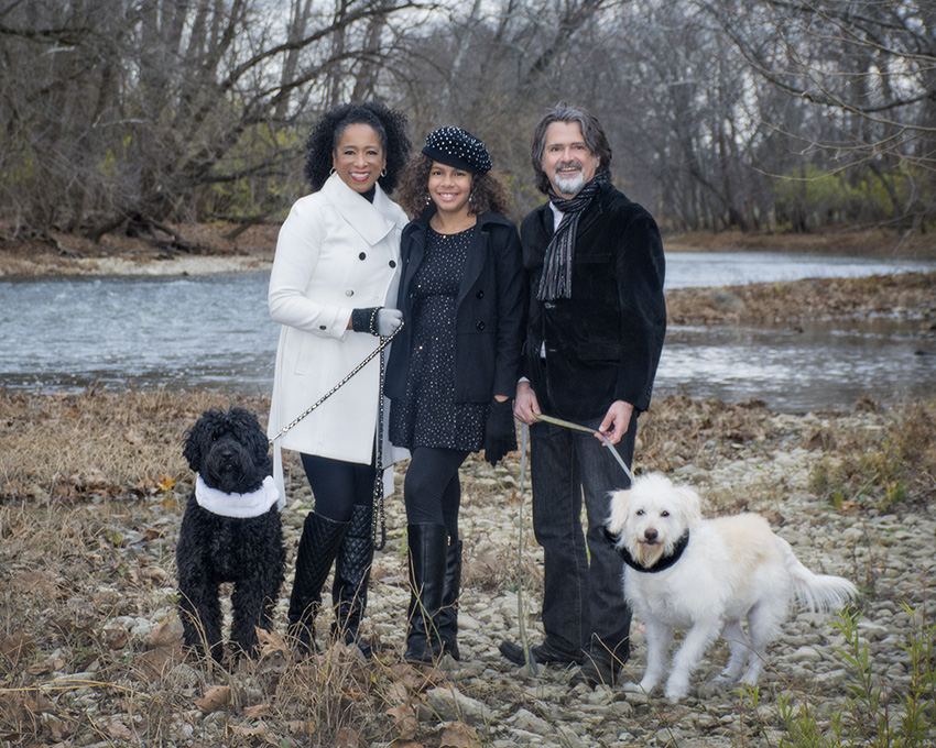 Outdoor family portrait by a river with their dogs by Dan Cleary of Cleary Creative Photography in Dayton Ohio