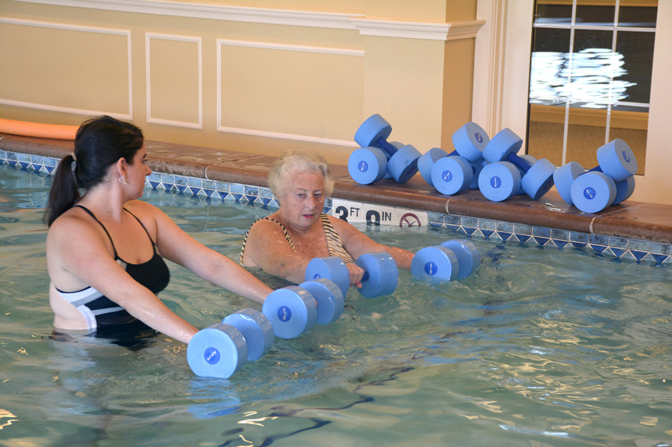 professional photograph at Kenwood Retirement community of nurse doing water therapy with an elderly woman by Dan Cleary of Cleary Creative Photography in Dayton Ohio