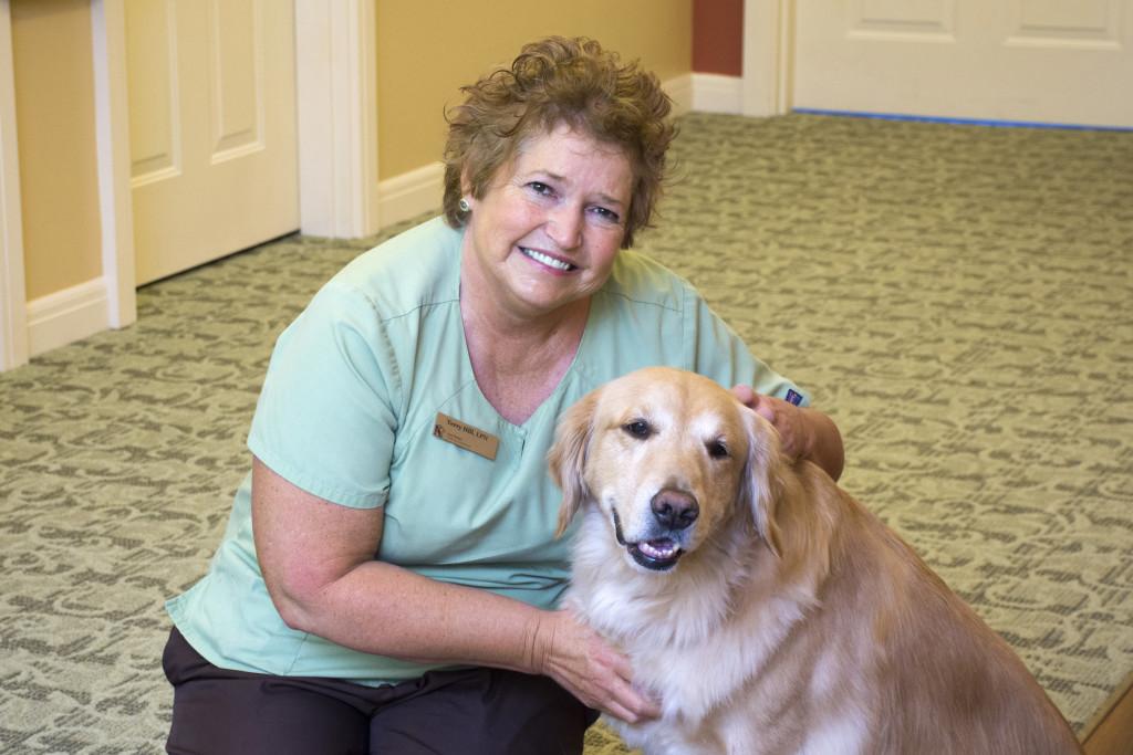 professional photograph at Kenwood Retirement community of nurse with dog by Dan Cleary of Cleary Creative Photography in Dayton Ohio